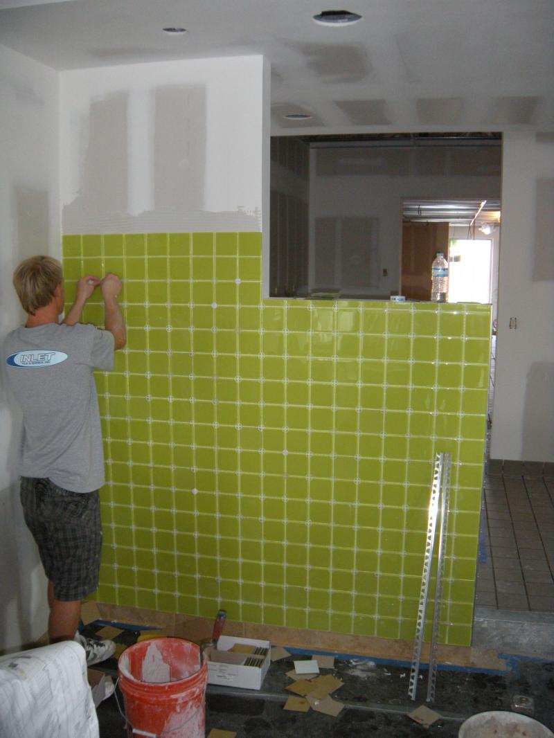 Dan working on glass tile wall at Dairy Queen West Palm